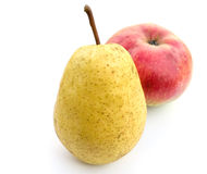 Pear and apple. Yellow pear and red apple on a white background Stock Photos
