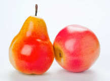Pear and apple. On white background Royalty Free Stock Image