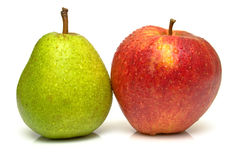 Pear and apple. Juicy green pear and ripe red apple. Isolated, shallow DOF Royalty Free Stock Images