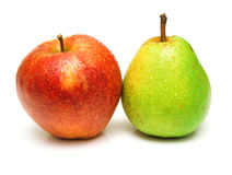 Pear and apple. Juicy green pear and ripe red apple. Isolated, shallow DOF Royalty Free Stock Photography