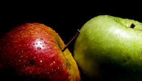 Pear and apple. Isolated on black background Stock Image