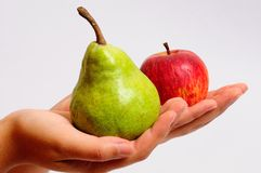 Pear or apple. Pear and apple being offered Royalty Free Stock Photos
