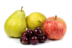 Pear apple and cherry. On a white background Royalty Free Stock Photo