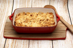 Pear and Apple crumble. On wood background Royalty Free Stock Photos