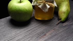 Pear, apple and honey stock video footage