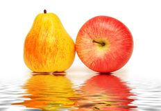 Pear and apple isolated. On the white Stock Images