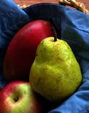 Pear,apple and mango. Pear apple and mango in a basket Royalty Free Stock Photography