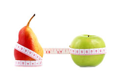Pear and apple measured the meter Royalty Free Stock Photography