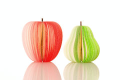 Pear and apple from paper. Slice isolated on the white background Stock Photography