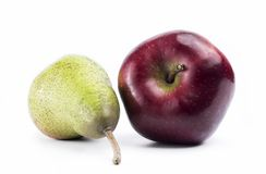 Pear and Apple. Photo of pear and apple on a white background. It gives the user the ability to easily and cleanly crop/cut the object and use it for all sorts Royalty Free Stock Photos