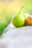 Pear, apple and plum Stock Photography