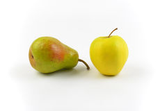 Pear and apple. Ripe pear and apple on white background Royalty Free Stock Image