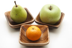 Pear and apple with tangerine Royalty Free Stock Image