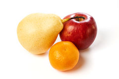 Pear, apple and tangerine isolated Royalty Free Stock Photo