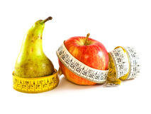 Pear and apple with tape measure. Illustrating types of woman figure Royalty Free Stock Image
