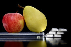 Pear and apple on a tray and medicine Royalty Free Stock Image