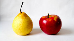 Pear and apple. Yellow pear & red apple Royalty Free Stock Photography