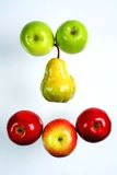 Pear between apples Royalty Free Stock Photos