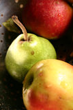 Pear & apples. Washed in a bowl Royalty Free Stock Images