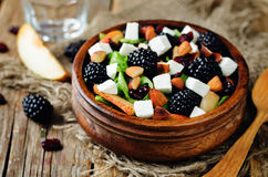Pear arugula blackberry almond goat cheese dried cranberry salad. Toning. selective focus Royalty Free Stock Photo