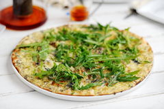 Pear arugula pizza. On white backround Royalty Free Stock Photography