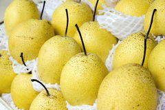 Pear background. A few of ripe light yellow pears with a black stem Stock Image