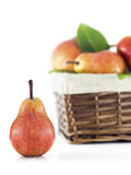 Pear with a basket in the background Royalty Free Stock Photos
