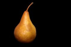 Pear on black Stock Images