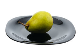 Pear on a black platte, isolated Stock Images
