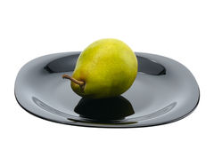 Pear on a black platte, isolated Stock Photos