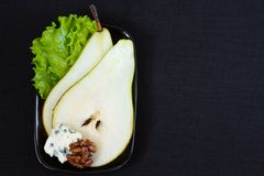 Pear with blue cheese. Stock Photography