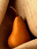 Pear on Burlap Royalty Free Stock Photos
