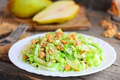 Pear and cabbage slaw. Home salad with fresh pear Royalty Free Stock Photo