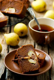 The pear cake with chocolate. Cut with slices on a wooden table. Selective focus. Style rustic stock photos