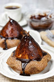Pear in cake with chocolate sauce Royalty Free Stock Images