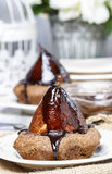 Pear in cake with chocolate sauce Royalty Free Stock Photos