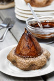 Pear in cake with chocolate sauce Royalty Free Stock Photography