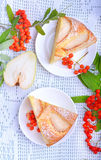 Pear cake. In white plate on white table Royalty Free Stock Photography