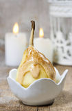 Pear with caramel sauce Royalty Free Stock Photo