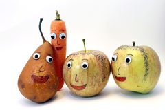 PEAR and carrot and two apples with big eyes Royalty Free Stock Images