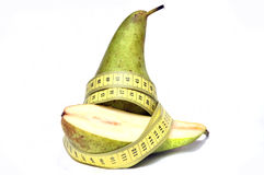 Pear and centimeter Stock Photos
