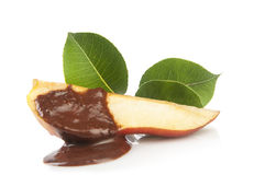 Pear with chocolate and green leaves Royalty Free Stock Photography