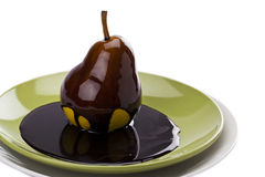 Pear with chocolate Stock Images