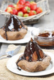 Pear with chocolate on party table Royalty Free Stock Image