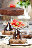 Pear with chocolate on party table Royalty Free Stock Photography