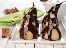 Pear with chocolate sauce Royalty Free Stock Images