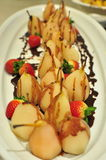Pear with chocolate and strawberries Royalty Free Stock Photos