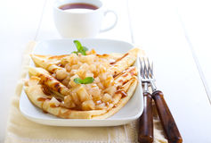 Pear, cinnamon and caramel crepes Stock Photography