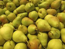 Pear. The close-up of green pear. A pile of pear, on the counter in a supermarket royalty free stock images