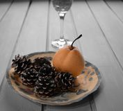 Pear cone and wineglass Royalty Free Stock Photos